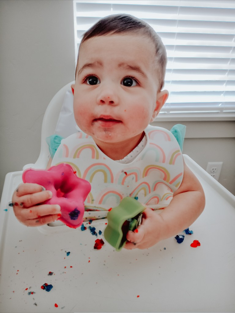 Cute messy baby with jiggler cups
