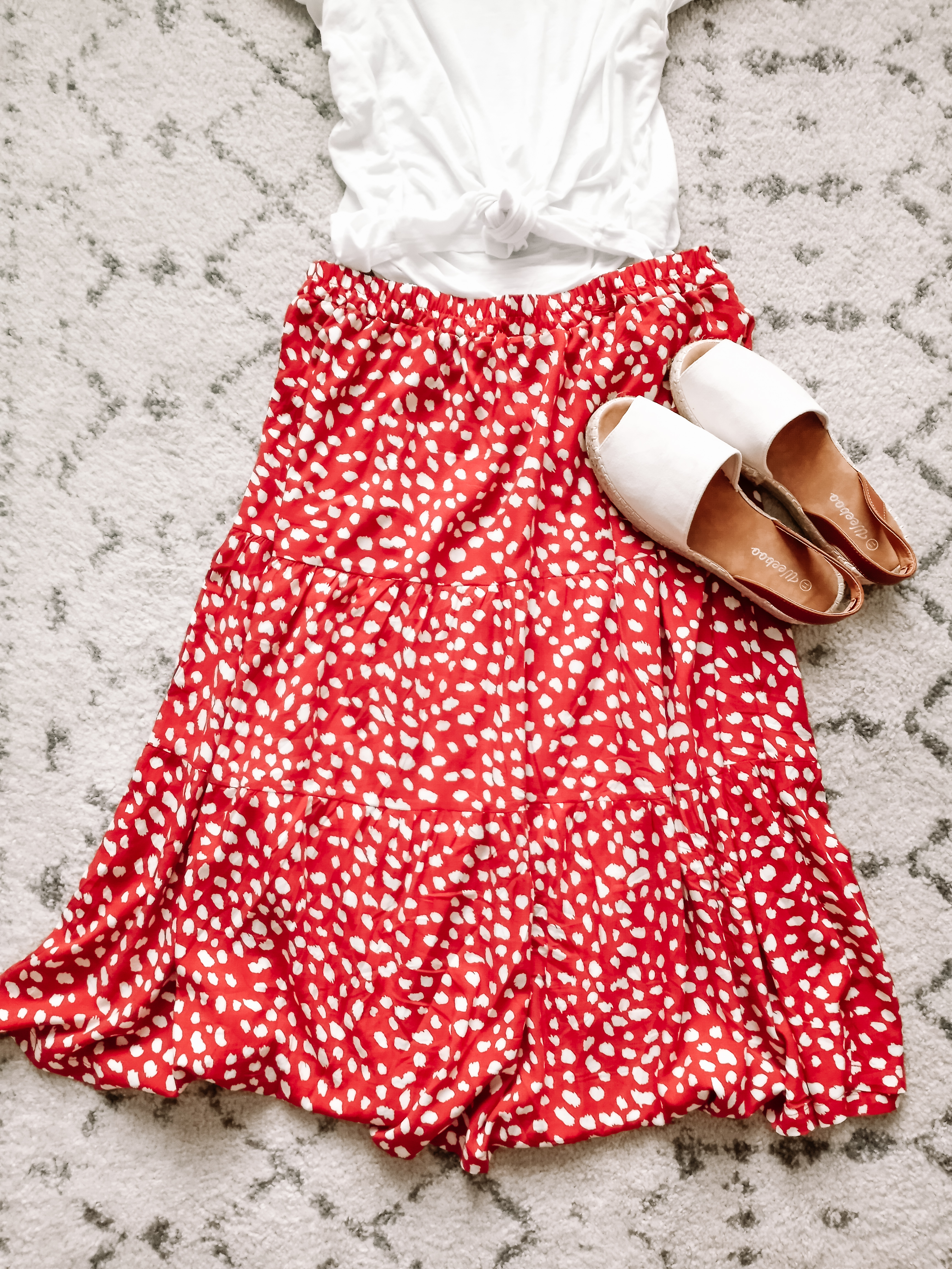 Rust red skirt perfect for moms with white tee and natural espadrilles